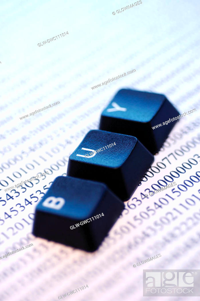 Stock Photo: Close-up of computer keys on a document.