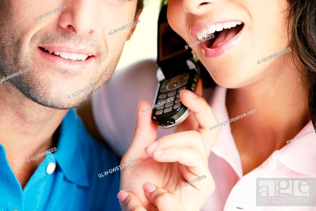Stock Photo: Close-up of a young couple using a mobile phone.