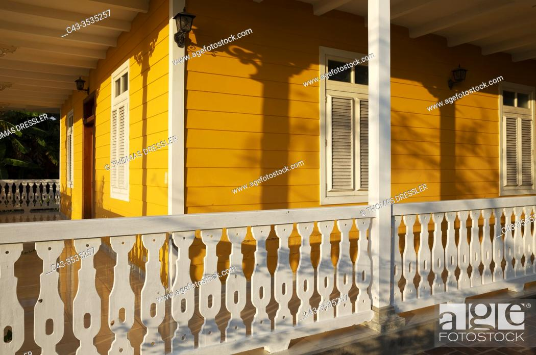 Stock Photo: Partial view of a well preserved colonial building that offers rooms for rent. Cienfuegos, Cuba.