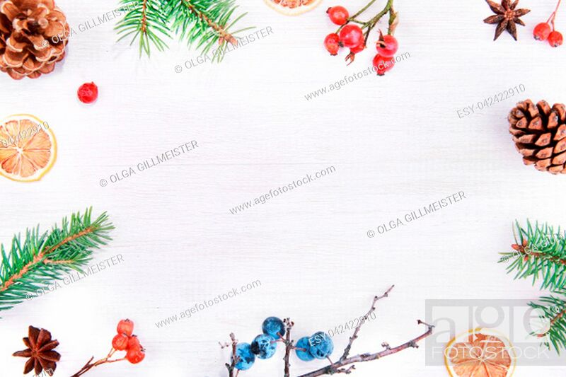 Stock Photo: Christmas winter or Happy New Year decoration background. Natur frame composition made from christmas tree branches, pine cones and colorful berries on a rustic.