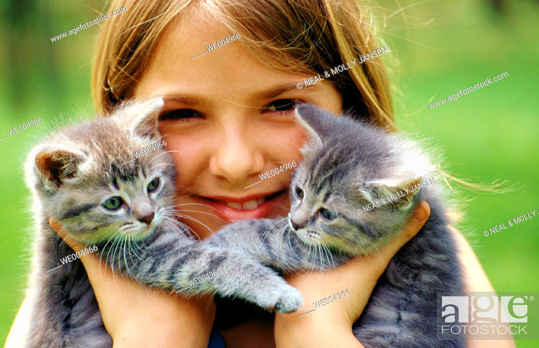 Stock Photo: Twin kittens with young girl, 10 yrs. Old.