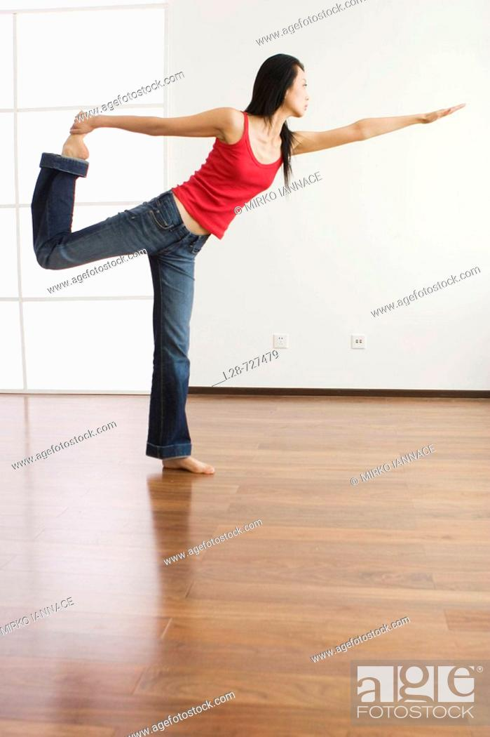 Stock Photo: Woman Doing Yoga At Home.