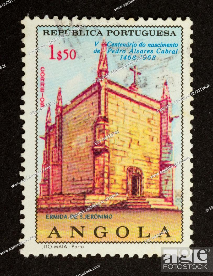 Stock Photo: ANGOLA - 1968: Stamp printed in Angola shows an old building, 1968.