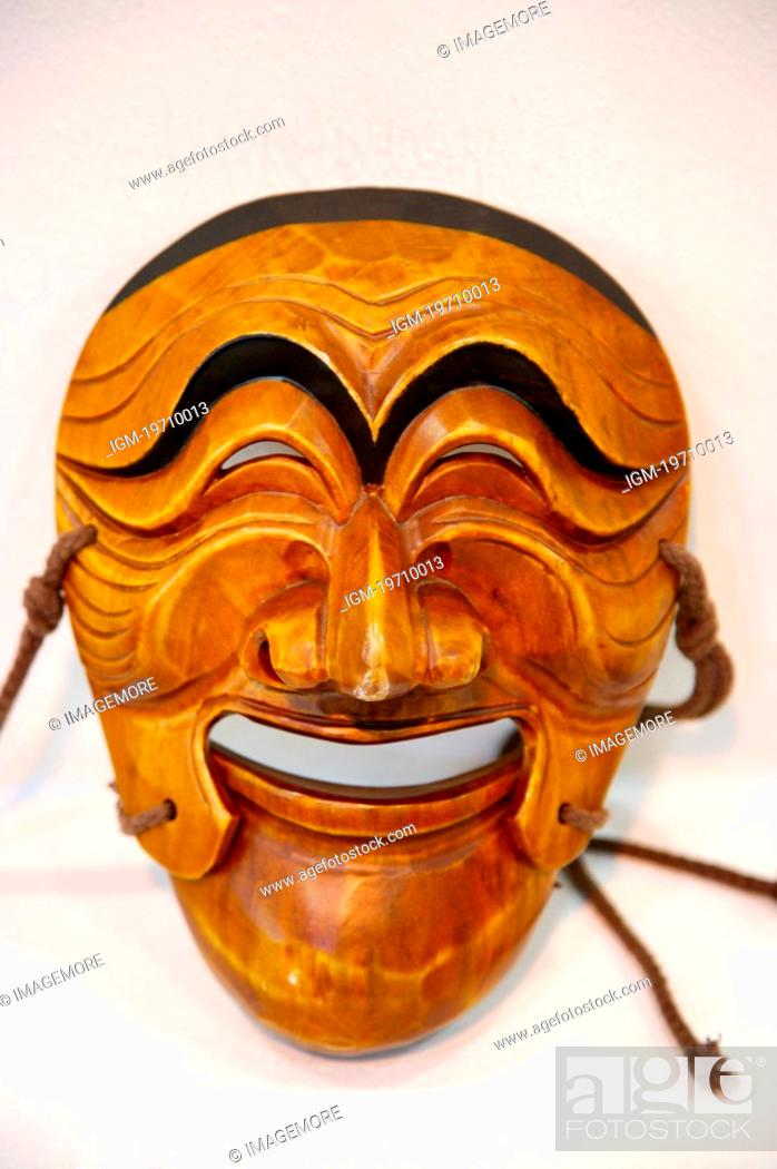 Stock Photo: Asia, South Korea, Traditional Korean carved wooden mask, front view, close-up.