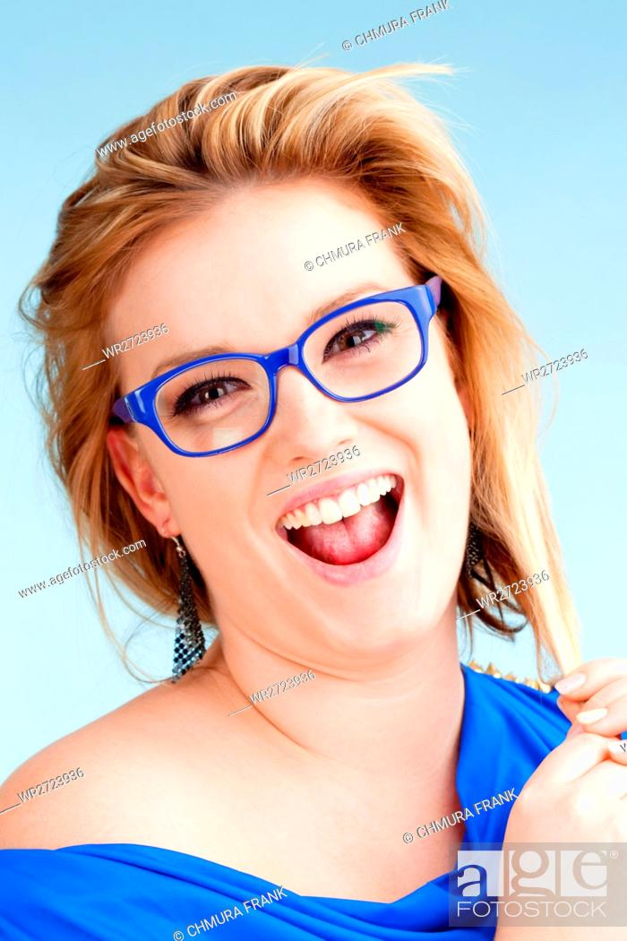 Stock Photo: Portrait of Young Woman with Blond Hair Smiling - Isolated on Blue.