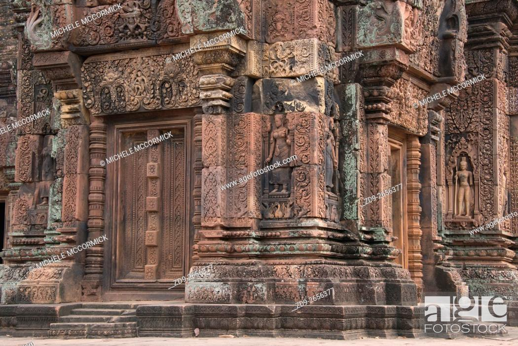 Stock Photo: The ancient pink stones distinguish the temple at Banteay Srey near Siem Reap.