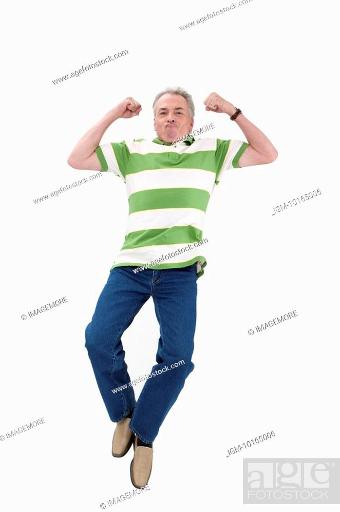 Stock Photo: Domestic Life, Senior-aged man jumping in mid-air with hands up.