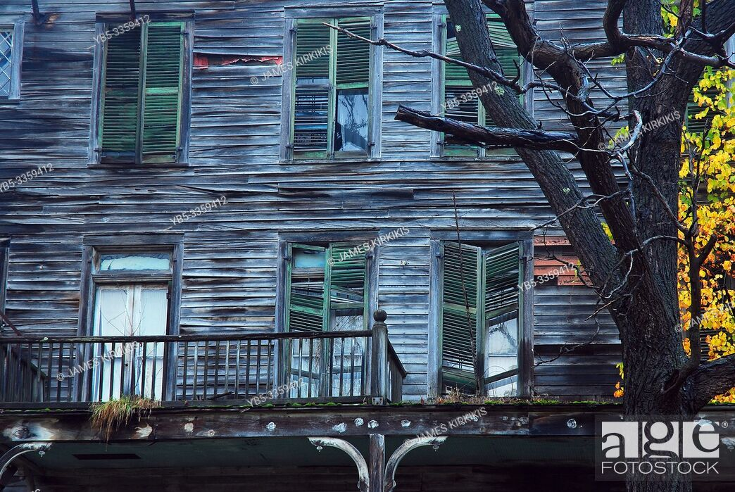 Stock Photo: An abandoned wooden home starts to decay and fall apart.