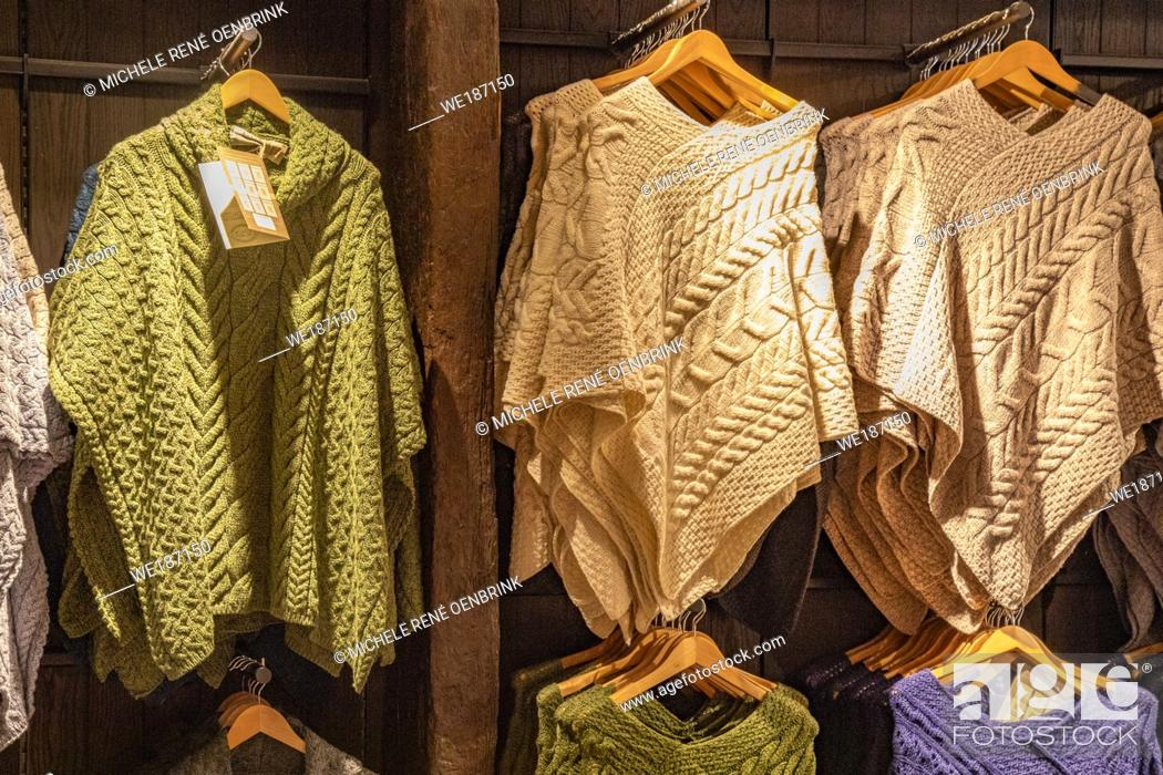 Stock Photo: Wool Aran sweaters and garmets for sale in, store selling warm clothing in Galway Ireland.