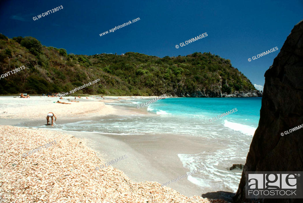 Stock Photo: Side view of people sunbathing on a beach on a sunny day, St. Bant's.