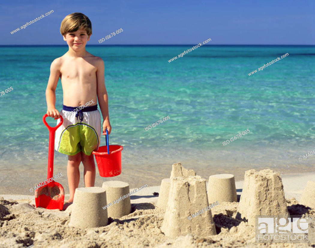 Stock Photo: Boy with sandcastles.