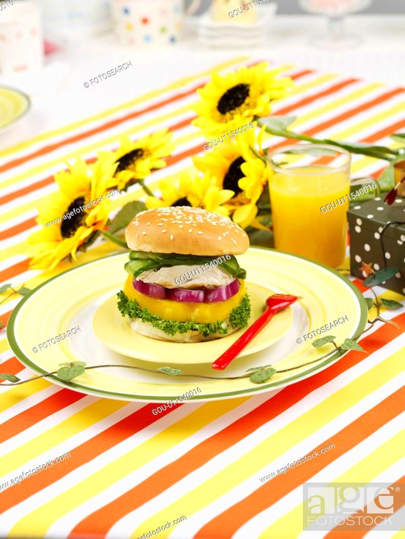 Stock Photo: glass cup, plate, sunflower, leaf, tablecloth, orange juice, dish.