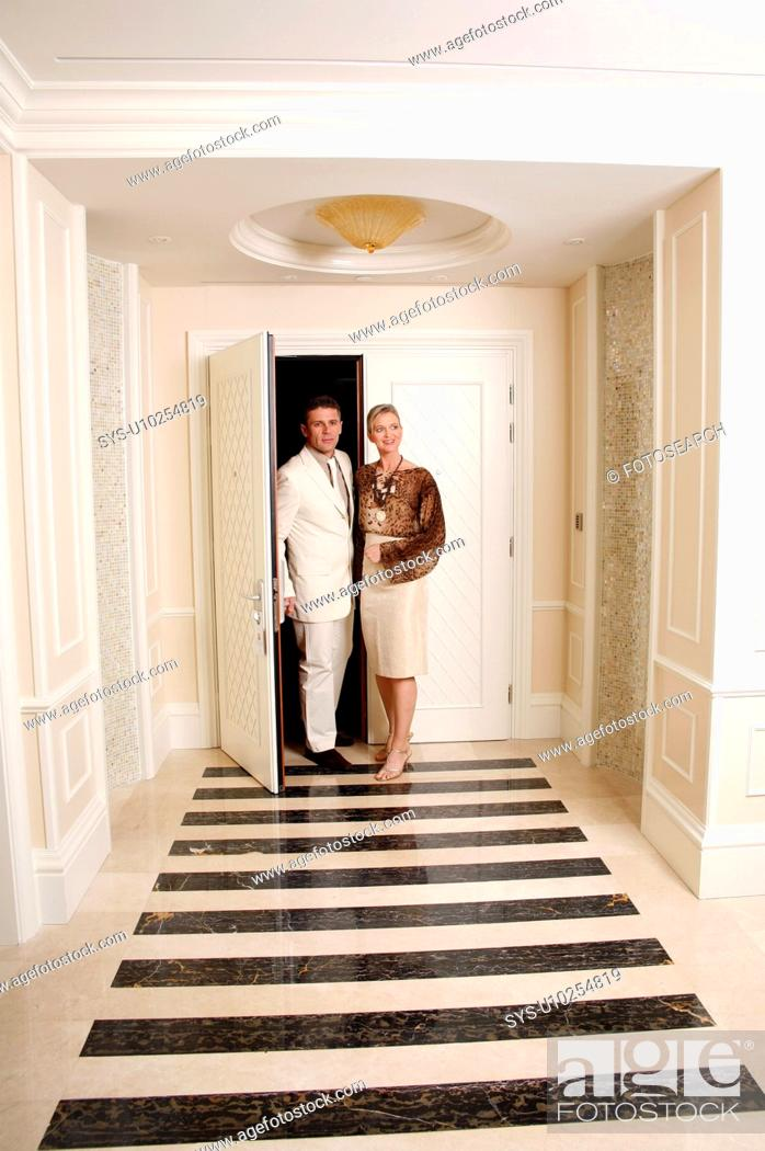 Stock Photo: Mature couple entering a hotel suite.