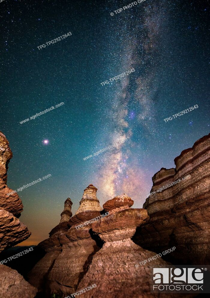 Stock Photo: Milky way of Starry Night upon the Rock in the desert; somewhere unknown.