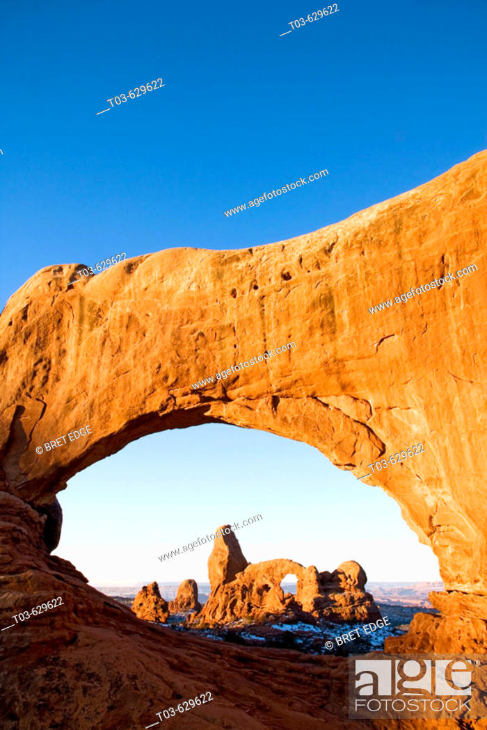 Stock Photo: Turret Arch framed through North Window at sunrise, Arches National Park, Utah, USA.