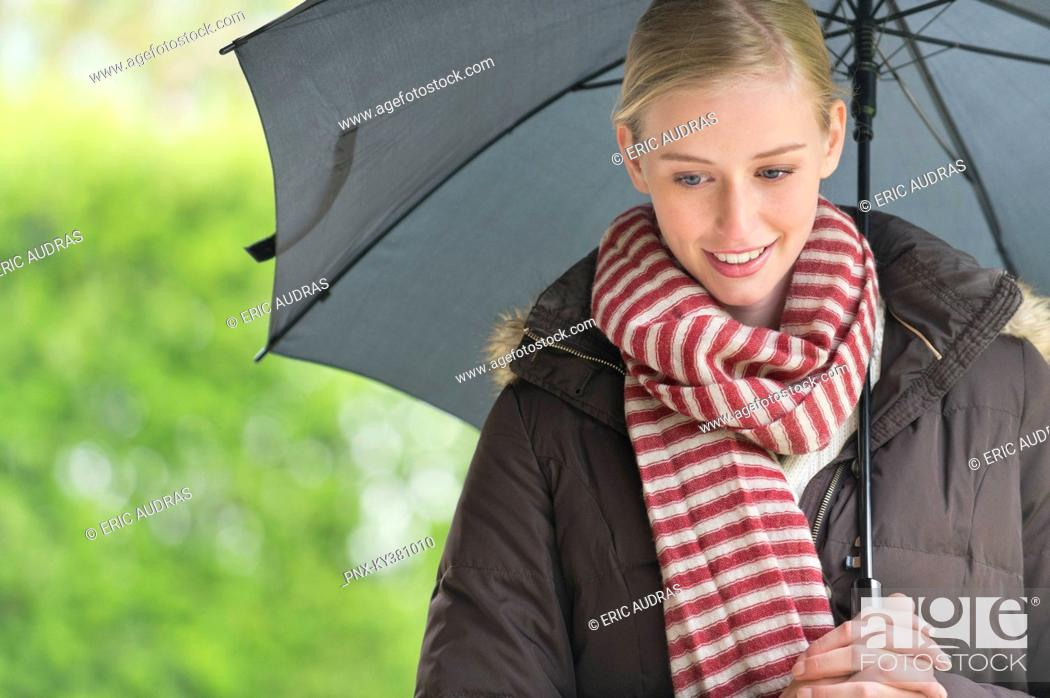 Stock Photo: Close-up of a woman with an umbrella.