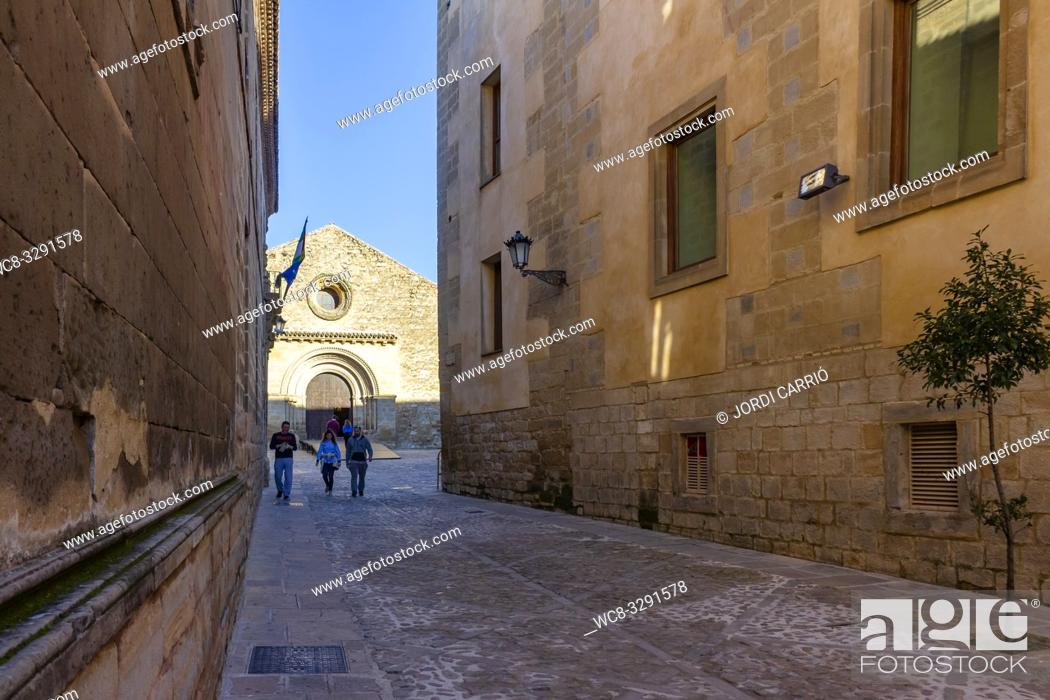 Stock Photo: Baeza, Andalusia, Spain: View of one of the streets of the medieval center of Baeza with the Church of the Holy Cross in the background.