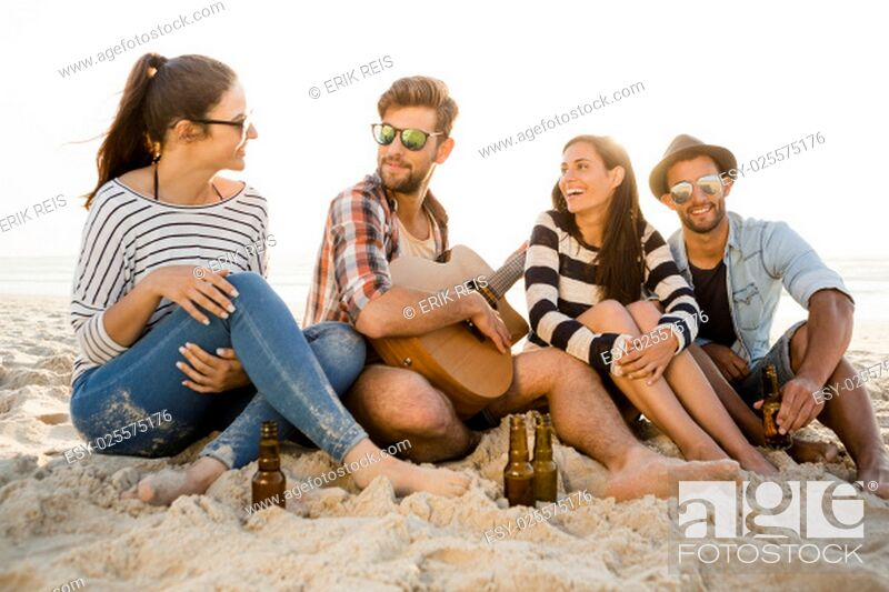 Stock Photo: Friends at the beach having fun together.
