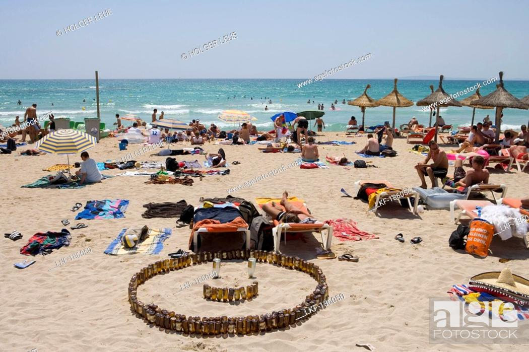 Stock Photo: San Miguel Beer Bottle Smile on Beach, El Arenal, Playa de Palma, Mallorca, Balearic Islands, Spain.