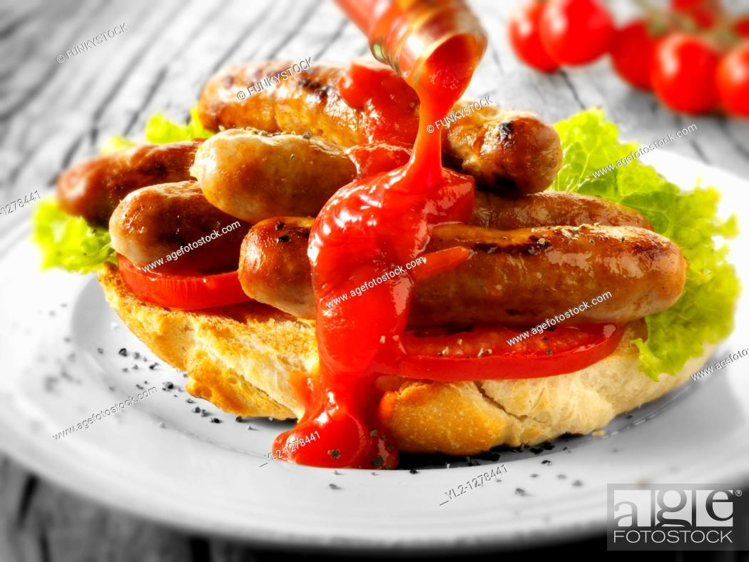Stock Photo: Traditional chipolatta pork sausages with tomato ketchup sandwich.