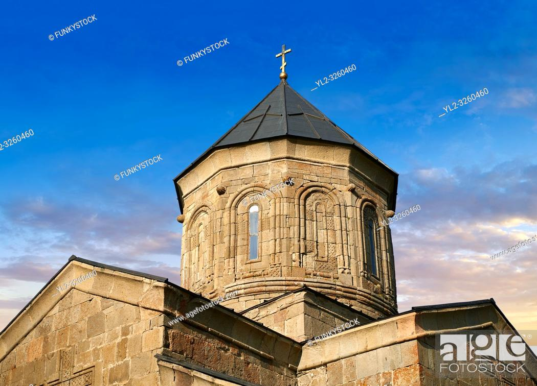 Stock Photo: Pictures & images of Gergeti Holy Trinity (Tsminda Sameba) Georgian Orthodox and Apostolic Church cupola close up, 14th century, Gergeti, Khevi province.
