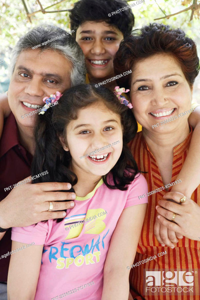 Stock Photo: Portrait of grandparents and their two grandchildren smiling.
