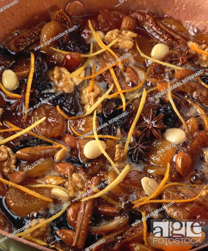 Stock Photo: Bottled dried fruit with nuts, almonds and spices.