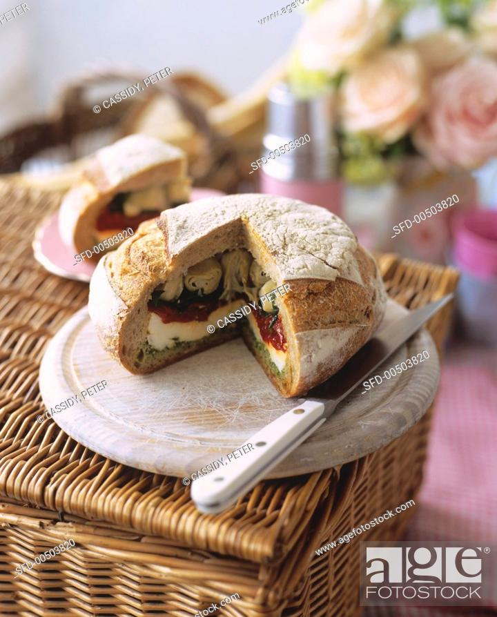 Stock Photo: Picnic loaf stuffed with antipasti.