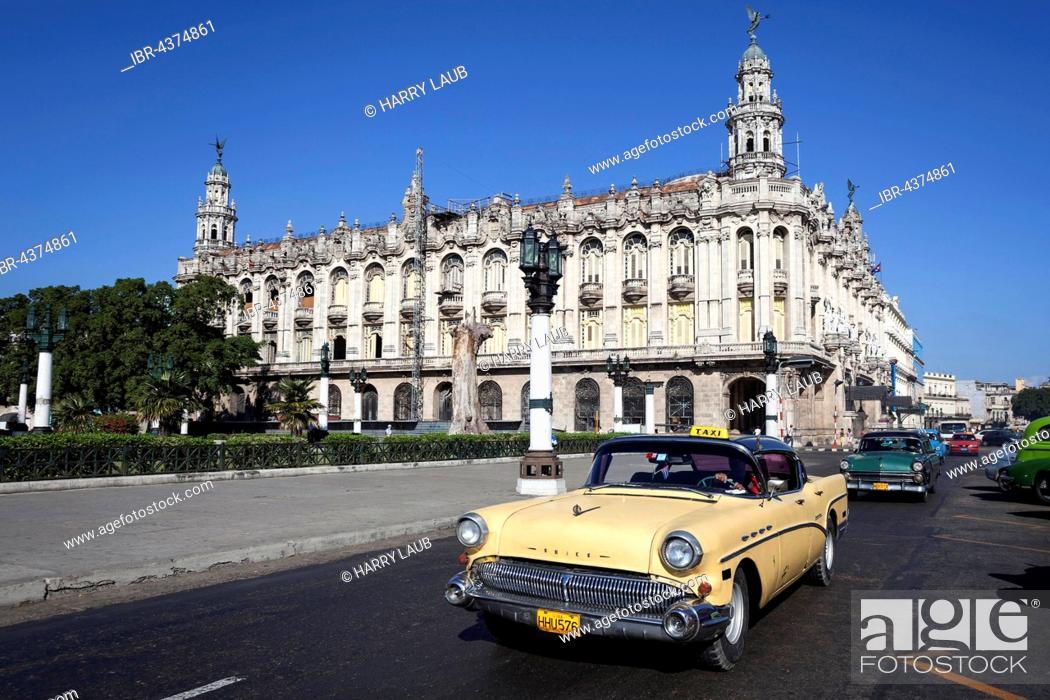 Stock Photo: Street scenery, Oldtimer driving in front of Gran Teatro de La Habana Alicia Alonso, on the Prado, Havana, Cuba.