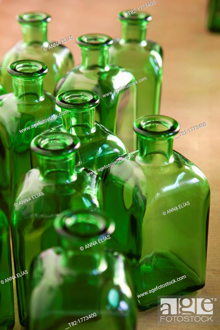 Stock Photo: perspective of numerous bottles of green glass.