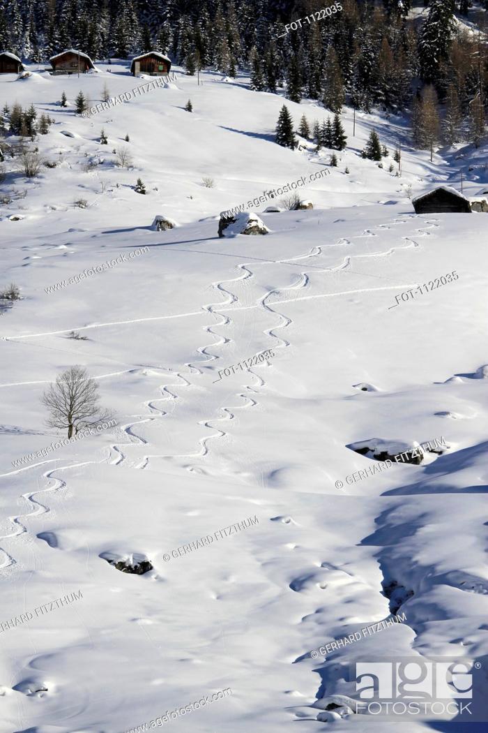 Stock Photo: Curvy snow tracks.