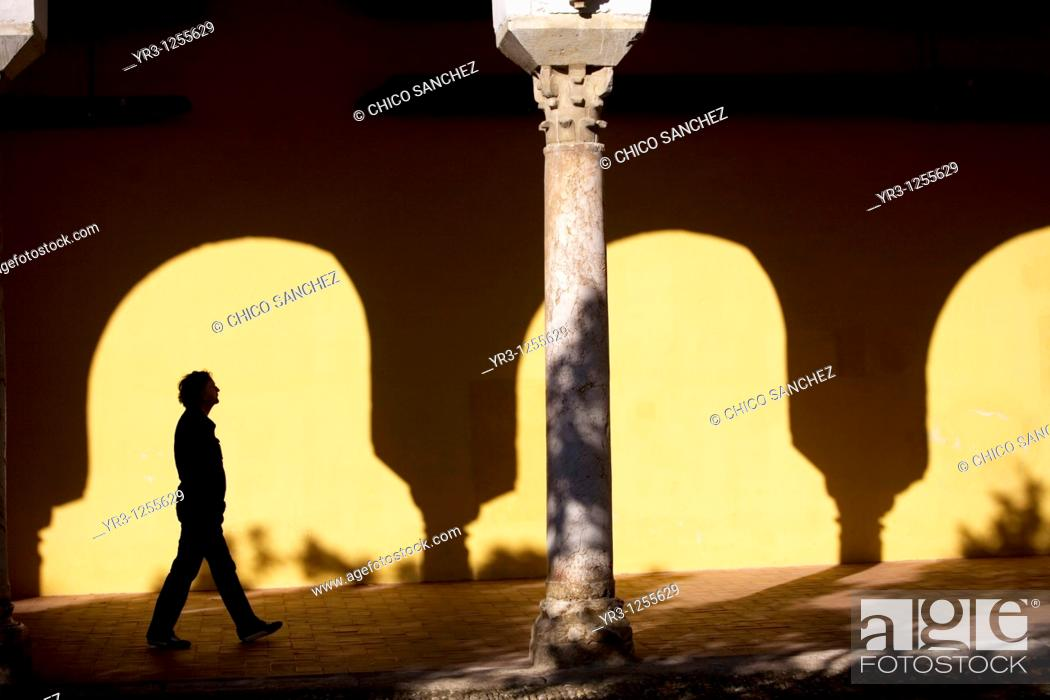 Stock Photo: A tourist walks in the Mosque and Cathedral of Cordoba, Andalusia, Spain.