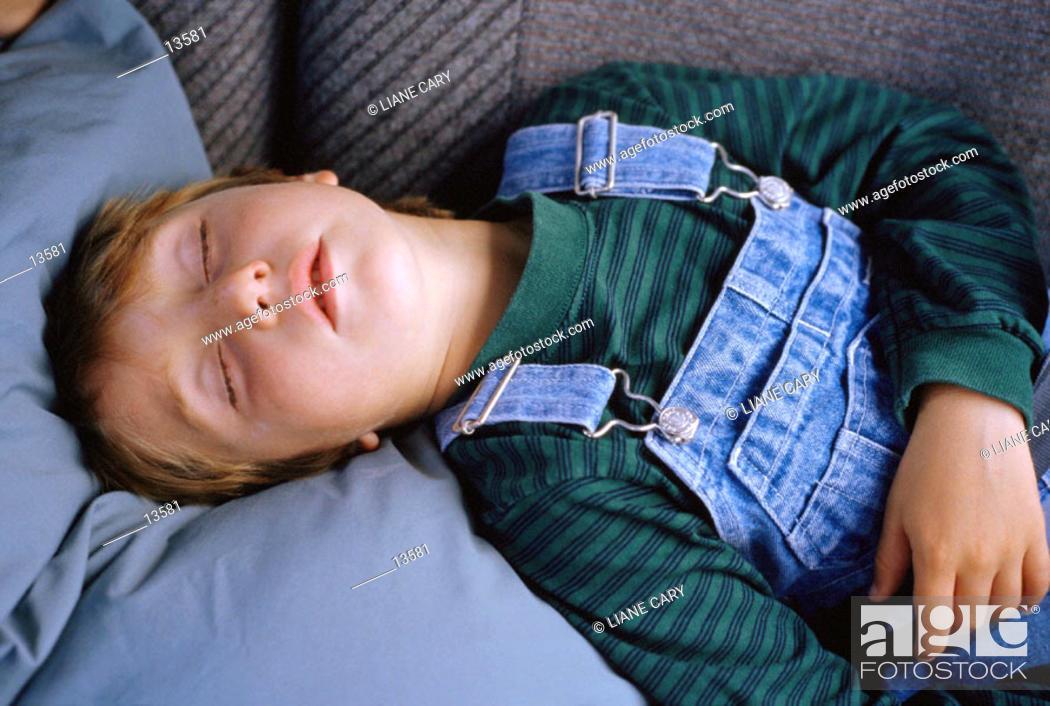 Stock Photo: Young boy sleeping.
