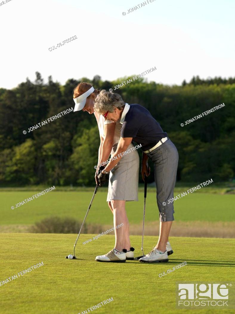 Stock Photo: Two women on golf green.