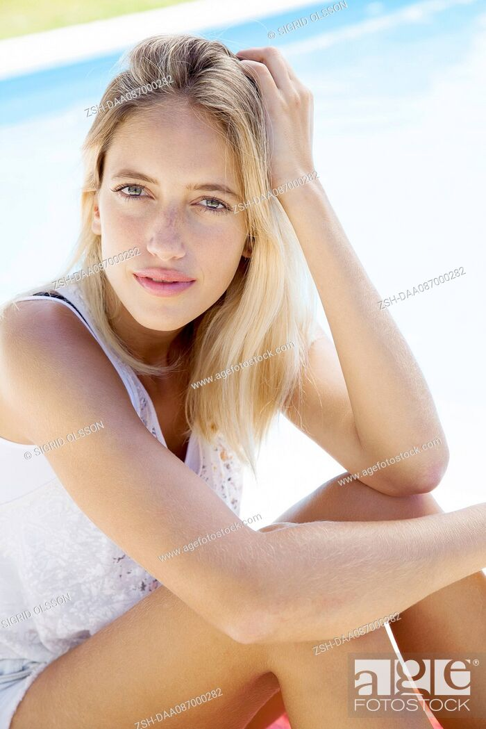 Stock Photo: Woman at poolside, portrait.