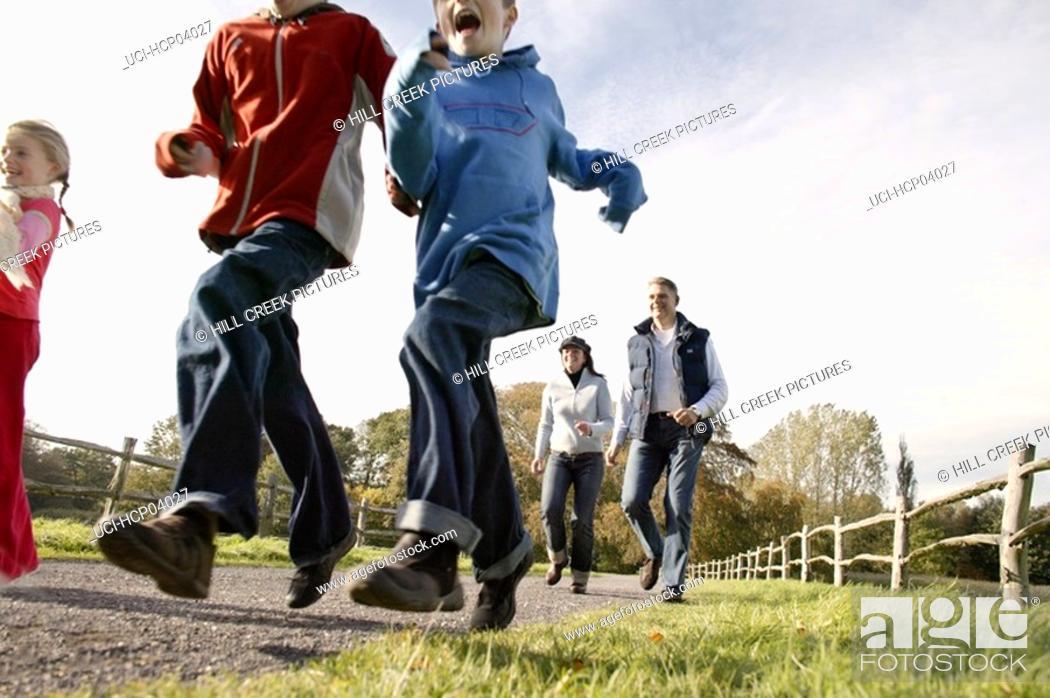 Stock Photo: Family running outside.