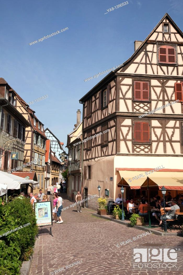 Stock Photo: Rue de la Poissonnerie, Little Venice, Colmar, Alsace, France, Europe / Historic buildings on narrow cobbled street in the Little Venice area of the old town.