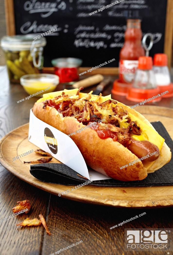 Stock Photo: A hotdog with cheese and ketchup at a fast food cafe.
