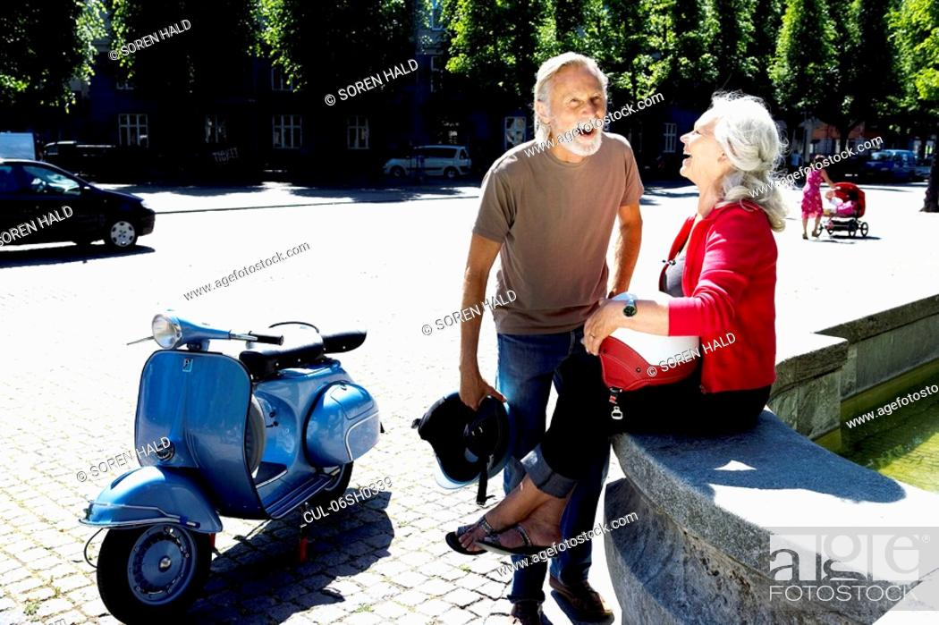 Stock Photo: Couple having a break with scooter.