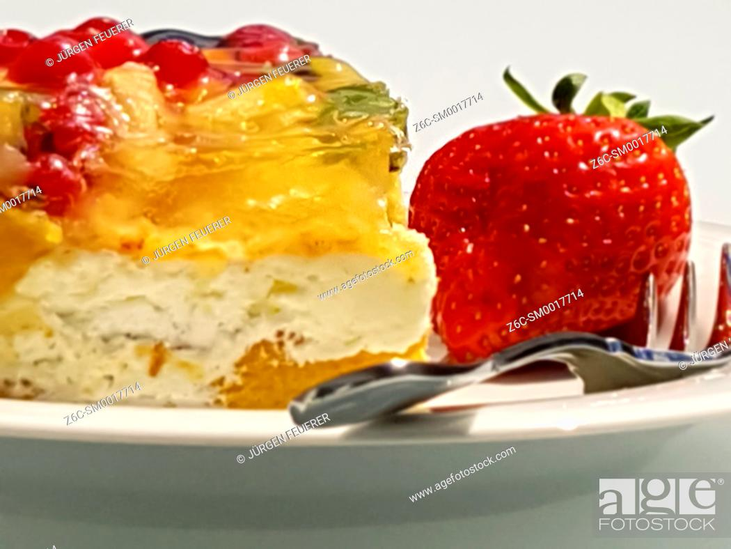Stock Photo: piece of colorful fruit cake with layers and strawberry.