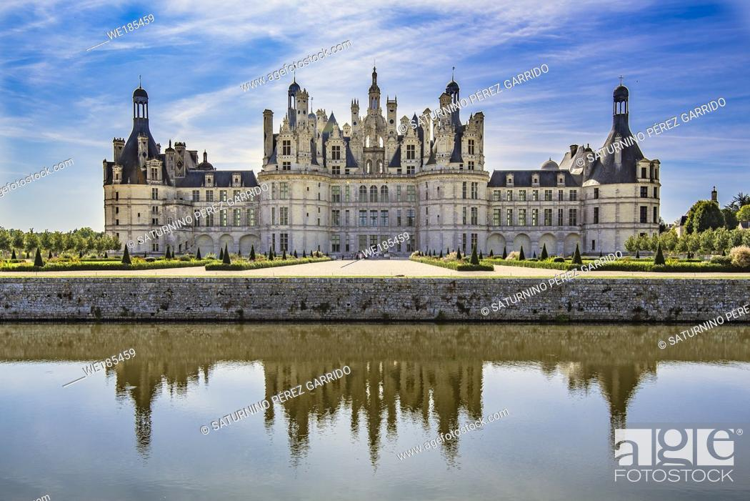 Stock Photo: Chambord Castle reflected in the surrounding water.