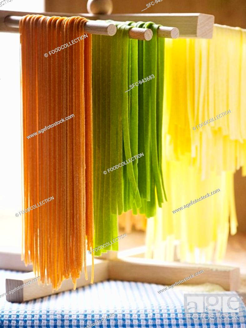 Stock Photo: Coloured pasta hanging up to dry.