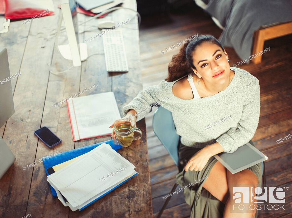 Stock Photo: Portrait confident college student studying with tea and digital tablet.