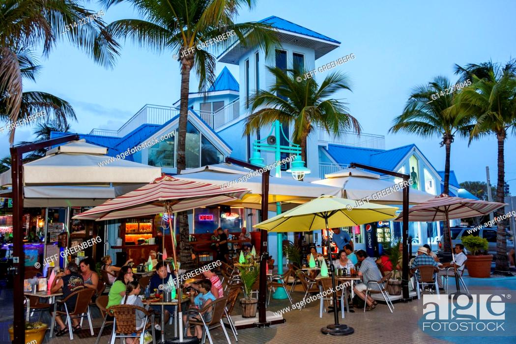 Stock Photo Florida Fort Ft Myers Beach Estero Boulevard Time Times Square Alfresco Dining Umbrellas Restaurant Night Nightlife Family