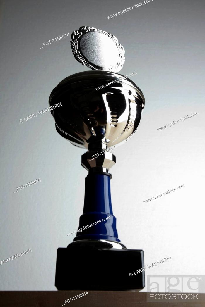 Stock Photo: A silver trophy with blank plaque surrounded by laurel wreath.