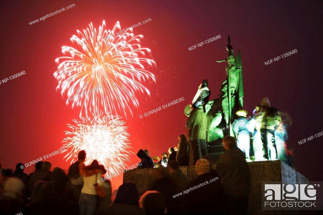 Stock Photo: People watching fireworks on Culture Night by Arnarholl, Reykjavik.
