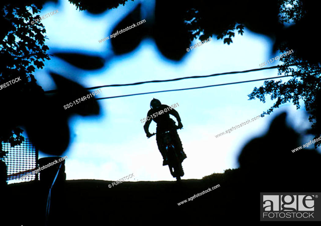 Stock Photo: Silhouette of a person riding a bicycle.