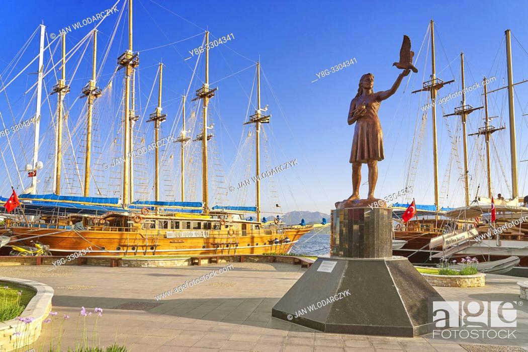 Stock Photo: Girl with Doves Statue, Marmaris marina, Turkey.