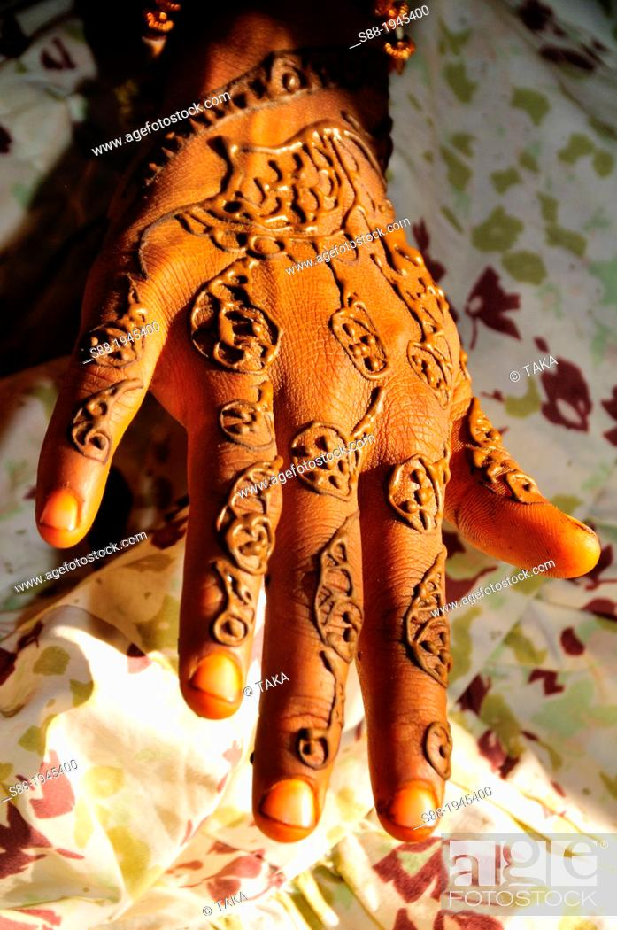 Stock Photo: On the day of marriage in the morning, bride having henna painting.