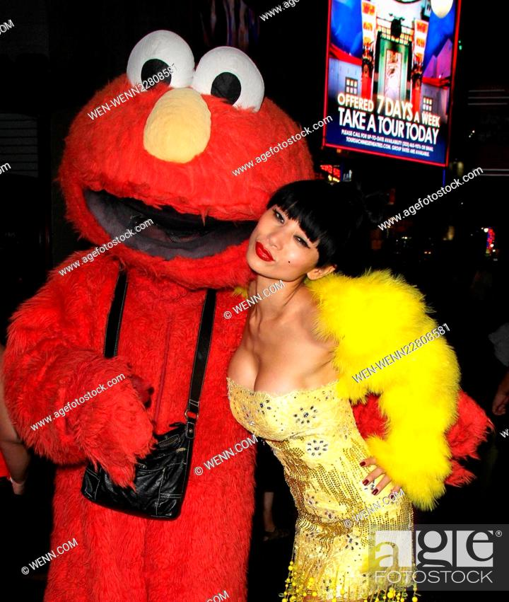 Bai Ling poses for pictures as she takes a 'Hollyweird' tour